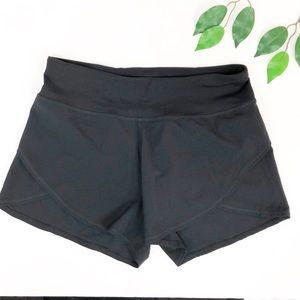 NEW. Calia Carrie Underwood black running shorts S